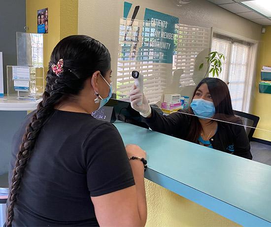 patient having temperature taken